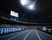 In this file photo taken on November 26, 2020 An homage to late Argentinian football legend Diego Maradona is displayed on a board (L) and on screen (Top L) prior to the UEFA Europe League Group F football match Napoli vs Rijeka on November 26, 2020 at the San Paolo stadium in Naples. Filippo MONTEFORTE / AFP