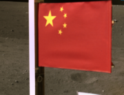 This picture taken and released on December 4, 2020, by the China National Space Administration (CNSA) via CNS shows a Chinese national flag unfurled from the Chang'e-5 lunar probe. China National Space Administration (CNSA) via CNS / AFP