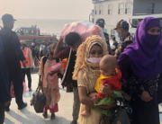 Rohingya refugees disembark from a Bangladesh Navy ship to the island of Bashar Char in Noakhali on December 4, 2020. Stringer / AFP