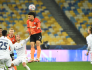 Shakhtar Donetsk's Brazilian midfielder Taison (C) heads the ball during the UEFA Champions League Group B football match between Shakhtar Donetsk and Real Madrid at the Olimpiyskiy stadium in Kiev on December 1, 2020. Sergei SUPINSKY / A