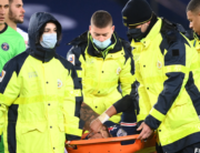 Paris Saint-Germain's Brazilian forward Neymar (C) is evacuated on a stretcher during the French L1 football match between Paris Saint-Germain (PSG) and Lyon (OL), on December 13, 2020 at the Parc des Princes stadium in Paris. FRANCK FIFE / AFP
