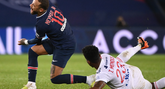 Paris Saint-Germain's Brazilian forward Neymar (L) is tackled by Lyon's Dutch defender Kenny Tete during the French L1 football match between Paris Saint-Germain (PSG) and Lyon (OL), on December 13, 2020 at the Parc des Princes stadium in Paris. FRANCK FIFE / AFP