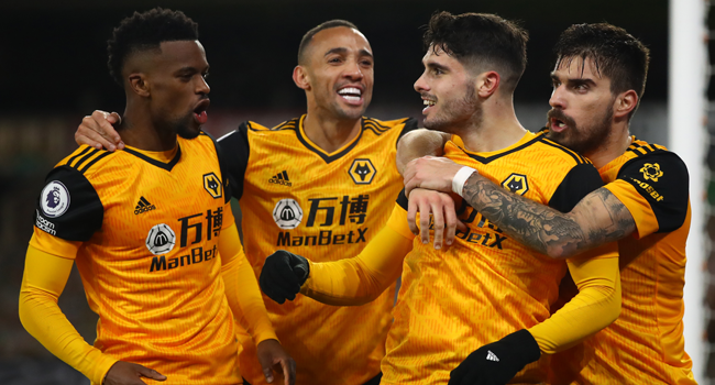 Wolverhampton Wanderers' Portuguese midfielder Pedro Neto (2R) celebrates scoring his team's second goal with teammates during the English Premier League football match between Wolverhampton Wanderers and Chelsea at the Molineux stadium in Wolverhampton, central England on December 15, 2020. (R) Michael Steele / POOL / AFP