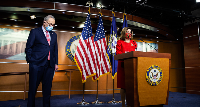 : Senate Minority Leader Chuck Schumer (D-NY) listens as Speaker of the House Nancy Pelosi (D-CA) speaks during a press conference on Capitol Hill on December 20, 2020 in Washington, DC. Tasos Katopodis/Getty Images/AFP