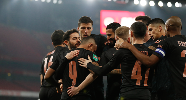 Manchester City's Brazilian striker Gabriel Jesus is congratulated after scoring his team's first goal during the English League Cup quarter final football match between Arsenal and Manchester City at the Emirates Stadium, in London on December 22, 2020. Adrian DENNIS / AFP