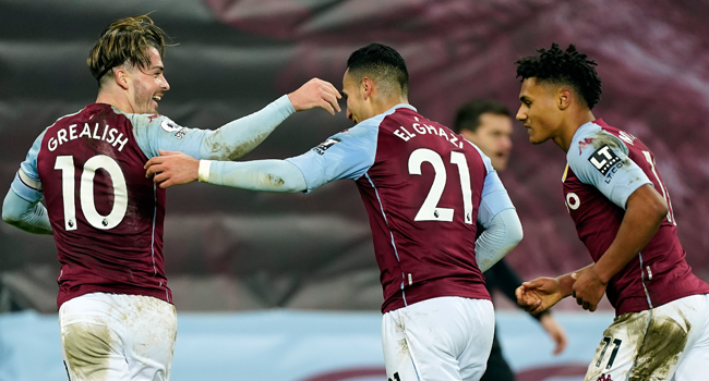 Aston Villa's English midfielder Jack Grealish (L) and Aston Villa's English striker Ollie Watkins (R) congratulate Aston Villa's Dutch striker Anwar El Ghazi after he scored their third goal during the English Premier League football match between Aston Villa and Crystal Palace at Villa Park in Birmingham, central England on December 26, 2020. Tim Keeton / POOL / AFP
