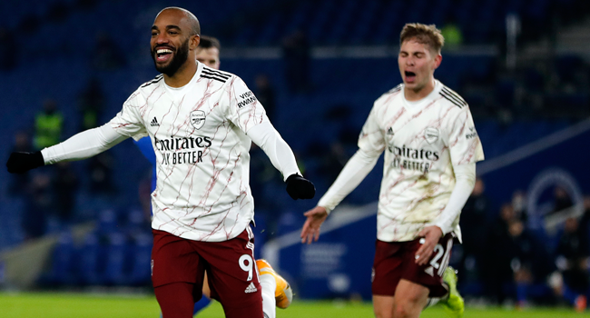 Arsenal's French striker Alexandre Lacazette celebrates scoring his team's first goal during the English Premier League football match between Brighton and Hove Albion and Arsenal at the American Express Community Stadium in Brighton, southern England on December 29, 2020. Frank Augstein / POOL / AFP