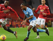 Manchester United's English defender Aaron Wan-Bissaka (L) vies with Manchester City's English midfielder Raheem Sterling (C) during the English Premier League football match between Manchester United and Manchester City at Old Trafford in Manchester, north west England, on December 12, 2020. Michael Regan / POOL / AFP