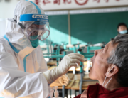 A medical worker takes a swab sample from a resident to test for the COVID-19 coronavirus in Shenyang, in China's northeast Liaoning province on December 31, 2020. STR / AFP