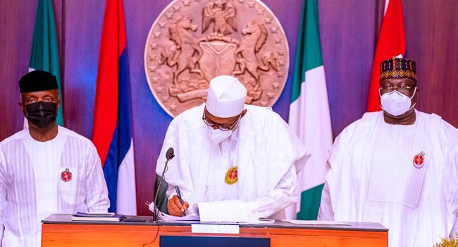 Buhari Signs 2021 Budget, Finance Bill Into Law