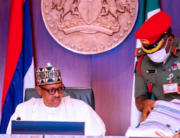 Outgoing ADC, Colonel Muhammad Abubakar (R) attends to President Muhammadu Buhari during a Federal Executive Council meeting on December 23, 2020. State House/Bayo Omoboriowo