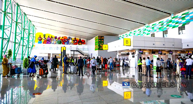 Nigerians Foreigners Storm Abuja Airport For International Travels
