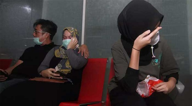 Families Of Indonesia Jet Crash Victims Hold Memorial At Sea