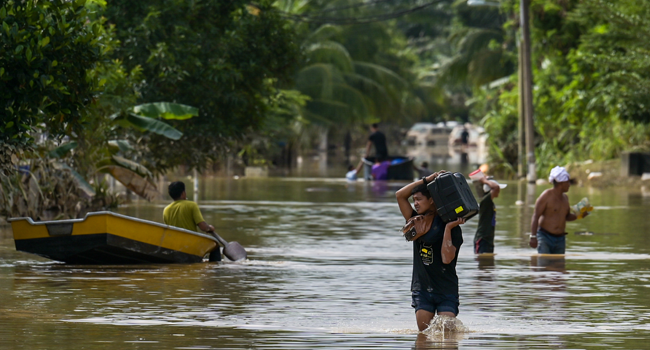 Six Dead, Nearly 50,000 Evacuated In Malaysia Floods