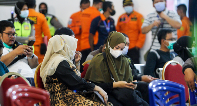 Relatives of passengers on board missing Sriwijaya Air flight SJY182 wait for news at the Supadio airport in Pontianak on January 9, 2021, after contact with the aircraft was lost shortly after take-off from Jakarta.  Louis ANDERSON / AFP
