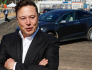 In this file photo Tesla CEO Elon Musk talks to media as he arrives to visit the construction site of the future US electric car giant Tesla in Gruenheide near Berlin on September 3, 2020. Odd ANDERSEN / AFP