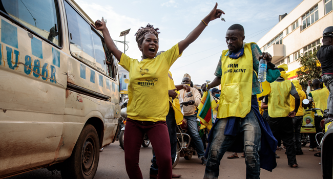 Supporters of incumbent Ugandan Presdent Yoveri Museveni celebrate in the streets of Kampala on January 16, 2021. Badru KATUMBA / AFP