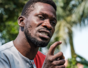 Musician turned politician Robert Kyagulanyi, aka Bobi Wine, addresses the media at his home in Wakiso, Uganda, on January 8, 2021 to announce his plans to take President Yoweri Museveni to the International Court Commission (ICC), accusing him of crimes against humanity over the past few months. SUMY SADURNI / AFP