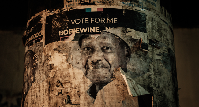 An old poster of Uganda's incumbent President Yoweri Museveni is seen on a an utility pole on the eve of Presidential and general elections on January 13, 2021, in Kampala, Uganda. YASUYOSHI CHIBA / AFP