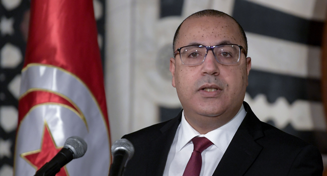 Tunisian Prime Minister Hichem Mechichi speaks during a press conference to announce a wide cabinet reshuffle in the capital Tunis, on January 16, 2021. FETHI BELAID / AFP