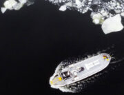 Aerial view shows a boat making its way through the icy water of Lidingo, near Stockholm, Sweden, on February 22, 2021. Jonathan NACKSTRAND / AFP
