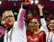 In this file photo taken on July 31, 2012, US women gymnastics team's coach John Geddert celebrates with the rest of the team after the US won gold in the women's team artistic gymnastics event at the London Olympic Games. AFP