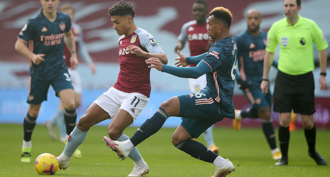 Aston Villa's English striker Ollie Watkins (L) takes on Arsenal's Brazilian defender Gabriel (R) during the English Premier League football match between Aston Villa and Arsenal at Villa Park in Birmingham, central England on February 6, 2021. Nick Potts / POOL / AFP