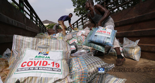 Workers offload food bags to be distributed to residents in Abuja as COVID-19 palliatives to ease the effect of the ongoing lockdown on April 17, 2020. Sodiq Adelakun/Channels TV