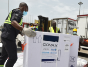 Workers unload a shipment of AstraZeneca Covid-19 vaccine bearing Covax stickers from a plane at Felix Houphouet Boigny airport of Abidjan on February 26, 2021. SIA KAMBOU / AFP