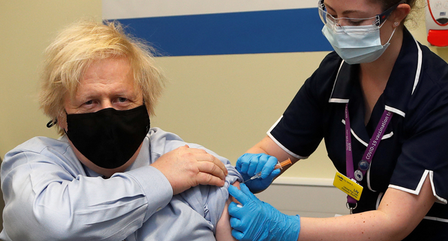 Britain's Prime Minister Boris Johnson receives a dose of a AstraZeneca/Oxford Covid-19 vaccine, administered by nurse and Clinical Pod Lead, Lily Harrington, at the vaccination centre in St Thomas' Hospital in London on March 19, 2021. Frank Augstein / POOL / AFP