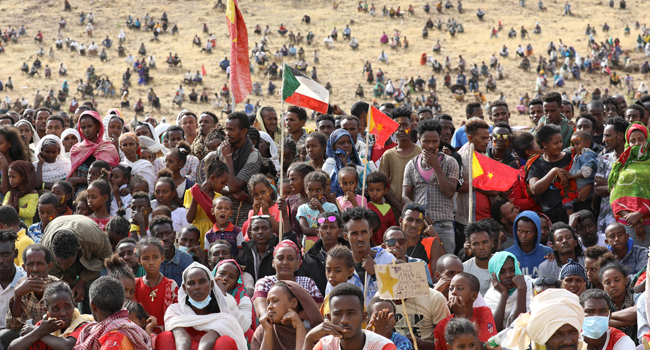 In this file photo taken on February 18, 2021 Ethiopian refugees gather to celebrate the 46th anniversary of the Tigray People's Liberation Front at Um Raquba refugee camp in Gedaref, eastern Sudan. Hussein Ery / AFP