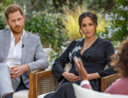 This undated image released March 7, 2021 courtesy of Harpo Productions shows Britain's Prince Harry (L) and his wife Meghan (C), Duchess of Sussex, in a conversation with US television host Oprah Winfrey. Joe PUGLIESE / HARPO PRODUCTIONS / AFP