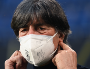 Germany's coach Joachim Loew wears a face mask as he arives for the FIFA World Cup Qatar 2022 qualification football match Germany v North Macedonia in Duisburg, western Germany on March 31, 2021. Ina Fassbender / AFP