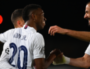 Real Madrid's Brazilian forward Vinicius Junior (C) celebrates with Real Madrid's French forward Karim Benzema (R) and Real Madrid's Spanish forward Lucas Vazquez after scoring a goal during the UEFA Champions League first leg quarter-final football match between Real Madrid and Liverpool at the Alfredo di Stefano stadium in Valdebebas in the outskirts of Madrid on April 6, 2021. GABRIEL BOUYS / AFP