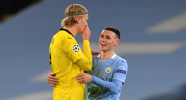 Manchester City's English midfielder Phil Foden (R) walks off the pitch with Dortmund's Norwegian forward Erling Braut Haaland after the UEFA Champions League first leg quarter-final football match between Manchester City and Borussia Dortmund at the Etihad Stadium in Manchester, north west England, on April 6, 2021. Paul ELLIS / AFP