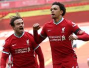 Liverpool's English defender Trent Alexander-Arnold (R) celebrates scoring his team's second goal during the English Premier League football match between Liverpool and Aston Villa at Anfield in Liverpool, north west England on April 10, 2021. Clive Brunskill / POOL / AFP