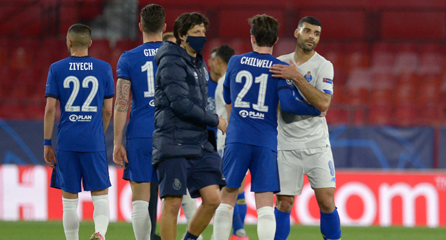 Chelsea's English defender Ben Chilwell (2R) congratulates FC Porto's Iranian forward Mehdi Taremi after the UEFA Champions League quarter final second leg football match between Chelsea and Porto at the Ramon Sanchez Pizjuan stadium in Seville on April 13, 2021. CRISTINA QUICLER / AFP