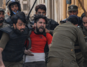 Policemen detain a supporter of Tehreek-e-Labbaik Pakistan (TLP) party during a protest against the arrest of their leader as he was demanding the expulsion of the French ambassador over depictions of Prophet Muhammad, in Rawalpindi on April 14, 2021. AFP