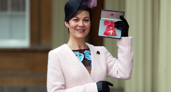In this file photo taken on November 07, 2017 English actress, Helen McCrory poses after she was awarded an Officer of the Most Excellent Order of the British Empire (OBE) for services to drama, by Britain's Queen Elizabeth II during an investiture ceremony at Buckingham Palace in central London. Steve Parsons / POOL / AFP