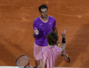 Spain's Rafael Nadal (Top) shakes hands with Russia's Andrey Rublev after their quarter final singles match on day seven of the Monte-Carlo ATP Masters Series tournament in Monaco on April 16, 2021. Valery HACHE / AFP