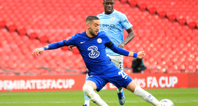 Chelsea's Moroccan midfielder Hakim Ziyech shoots to score the opening goal of the English FA Cup semi-final football match between Chelsea and Manchester City at Wembley Stadium in north west London on April 17, 2021. Adam Davy / POOL / AFP