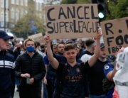 Football supporters demonstrate against the proposed European Super League outside of Stamford Bridge football stadium in London on April 20, 2021, ahead of the English Premier League match between Chelsea and Brighton and Hove Albion. Adrian DENNIS / AFP