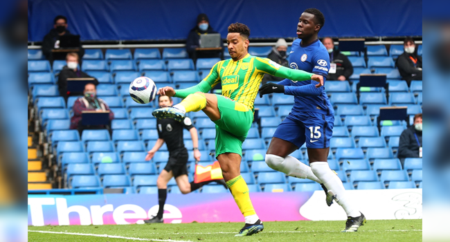 West Bromwich Albion's Brazilian midfielder Matheus Pereira (L) scores his team's opening goal during the English Premier League football match between Chelsea and West Bromwich Albion at Stamford Bridge in London on April 3, 2021. Clive Rose / POOL / AFP