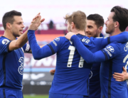 Chelsea's German striker Timo Werner (C) celebrates with teammates after scoring the opening goal of the English Premier League football match between West Ham United and Chelsea at The London Stadium, in east London on April 24, 2021. Andy Rain / POOL / AFP