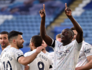 Manchester City's French defender Benjamin Mendy (R) celebrates scoring the opening goal during the English Premier League football match between Leicester City and Manchester City at King Power Stadium in Leicester, central England on April 3, 2021. Rui Vieira / POOL / AFP