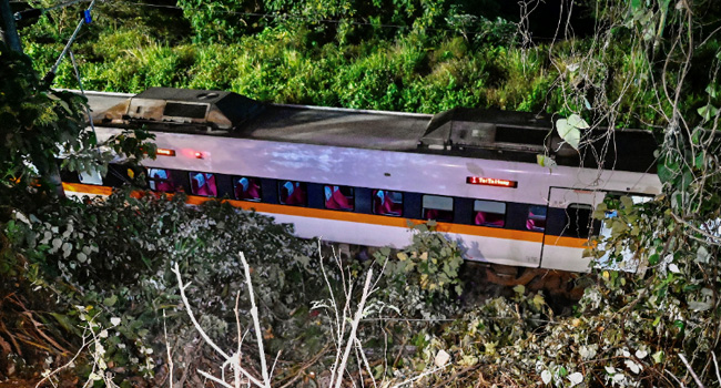 A general view shows a section of a train that derailed inside a tunnel in the mountains of Hualien eastern