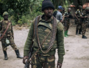 In this file photo taken on February 18, 2020 An Armed Forces of the Democratic Republic of Congo (FARDC) soldier takes part in a foot patrol in the village of Manzalaho near Beni, following an attack allegedly perpetrated by members of the rebel group Allied Democratic Forces (ADF).