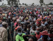 Residents displaced by the May 22, 2021 Mount Nyiragongo volcanic eruption wait to register to receive some aid distributed by a local politician and businessman in Goma on May 26, 2021.