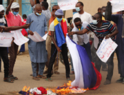 Chadian demonstrators carrying banners with anti France slogans, burn a homemade flag carrying the French colours at a protest in Ndjamena on May 8, 2021. Djimet WICHE / AFP
