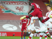 Liverpool's Senegalese striker Sadio Mane (C) heads home the opening goal during the English Premier League football match between Liverpool and Southampton at Anfield in Liverpool, north west England on May 8, 2021. Zac Goodwin / POOL / AFP